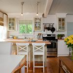 Adorable White Kitchen Design With Bar And Pendant And Woodne Floor And Wooden Table And White Dining Set With Ikea Chair