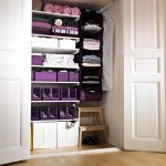 adorable white recessed dress up storage idea with storage bins and white doors and ladder