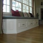 adorable window seats with storage in linier shape plus comfy upholstery and decorative cushion and amazing wooden floor and fireplace
