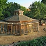 amazing-and-big-chicken-coop-with-tajmahal-design-with-orange-color-near-tractor-and-trees