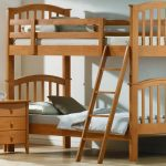 awesome classic low profile bunk bed design with railing and stairs and white bedding and dresser and potted plant and glass window