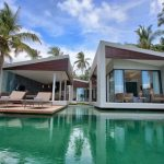 beach villa design idea in white tone with outdoor pool design and patio deck with coconut trees