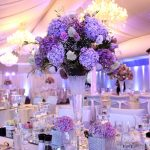 beautiful-and-elegant-centerpiece-ideas-for-wedding-reception-tables-with-white-and-purple-theme-and-purple-flowers-as-ccenterpieces-and-tall-centerpiece