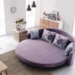 beautiful cheap round bed idea with patterned pillows and gray area rug and open plan and pendants and storage