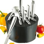 black-and-silver-finger-knife-block-design-by-raffaele-iannello-with-ABS-plastic-hand-block-and-have-six-slots-for-stainlees-steel-steak-knives