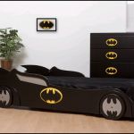 black-batman-car-bed-design-with-black-batman-dresser-and-brown-pot-and-plant-and-wooden-floor