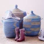 blue and white senegalese storage baskets for home decorated on the jute rug with pink boots
