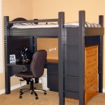 bold black wooden loft bed with desk design with brown swivel chair and wooden floor and storage