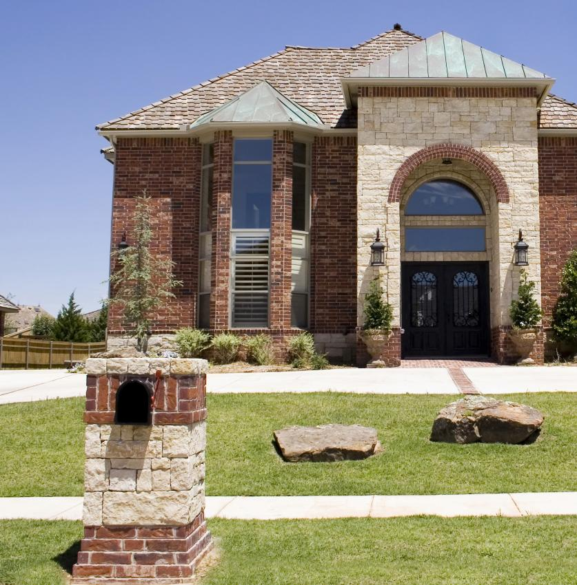 Bold Block Red Brick Mailbox Design Idea With White Accent Before A Luxurious House