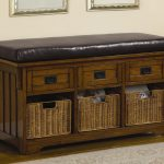 classic and traditional upholstered bench with storage with drawers and pretty baskets plus comfy leather top