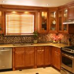 classic kitchen interior design with diy wooden storage and mosaic small tiles and glass window and beige countertop