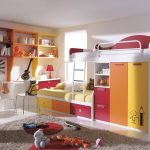 colorful loft desk conbo design with pink orange yellow and gray rug and bedding and wall shelves and desk and toys