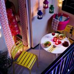Colorful Shabby Chic Balcony Idea With Black Fence And Yellow Chair And Round White Table And Pendant Lights