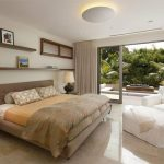 comfortable bedroom design with open plana and white barn sofa design with cream bedding and wall racks