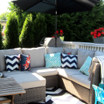 comfortable patio seating idea with black chevron target cushions idea with wooden table and black umbrella
