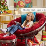 comfortable-red-papasan-chair-with-ottoman-and-red-carpet-with-gifts-and-white-table-and-christmas-tree