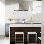 contemporary home kitchen bar idea with white tone and white cabinetry and white bar table and white stools