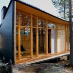 Contemporary Wooden House Design With Black Outter Siding And Beige Tone Inside With Open Plan And Wooden Floor