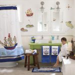 cute-blue-and-white-bathroom-design-with-sea-themed-for-kids-bathroom-with-white-double-sinks-on-the-green-table-also-two-mirrors-and-brown-stool-near-blue-towels