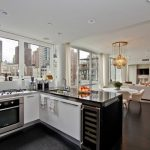 downtown living room with kitchen design with black white cabinetry and white sofa and open plan and city view