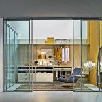 elegant and glamor dress up storage idea with comfortable chair and luxurious wardrobe design and sliding glass door