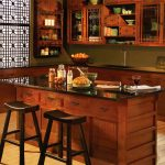 elegant and traditional home bar kitchen idea with wooden cabinetry and wooden island and wooden stools