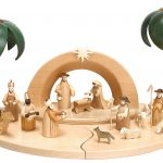 elegant creamy modern nativity set idea with coconut tree and church