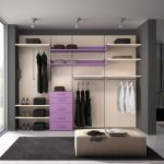 elegant dressing room idea with gray painted wall with purple accent and middl pouf wth black area rug and open concept