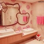 elegant-girly-bathroom-with-maroon-hello-kitty-wall-mirror-hang-on-the-soft-pink-wall-combined-with-white-furnitures-and-pink-towel-and-little-white-trash-can