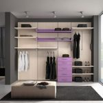 elegant open plan dress up storage design with cream purple combination with white pouf and black area rug