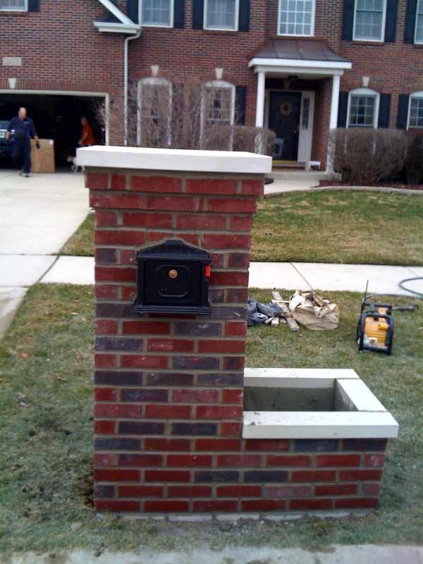 Elegant Reddish Brick Mailbox Idea With Tall Design And Box Planter White Accent Black