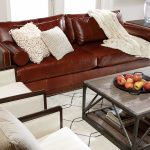 ethan allen leather furniture with brown leather sofa completed with comfy cushions and blanket plus rustic coffee table with book storage and white area rug