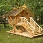 excellent-and-artistic-chicken-coop-made-of-wood-and-tree-house-design-with-light-color