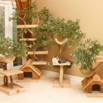 four-Unique-Cat-Tree-Houses-from-Pet-Tree-House-with-various-design-made-from-wood-near-beige-wall-and-soft-beige-floor-and-orange-curtain