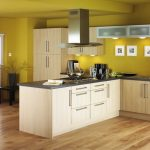 fresh tropical yellow kitchen paint idea with creamy cabinet and island and wooden floor