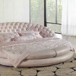 girly pink cheap round bed idea with tufted headboard and soft silky sheet on creamy patterned area rug with open plan