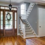 gorgeaour wooden glass image front door idea with lantern and wooden floor and white stairscase