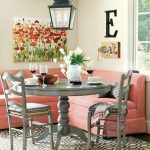 gorgeous breakfast nook with gray chairs and table and coral color sofa in the corner of a room with ethnic pendant