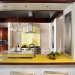 gorgeous kitchen studio design with modern yellow island and creamy stools and wooden ceiling and white wall and small glass window
