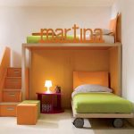 gorgeous orange low profile bunk bed for girls room with name spelling and green bolster and pouf and red nightstand