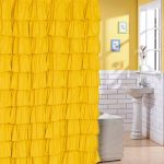 gorgeous yellow art deco shower curtain idea with ruffle and straight rod and yellow paint wall with white brick and freestanding sink