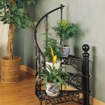 great indoor plan idea with black wrought iron in stairs shaper with railing beneath gray wall with potted plan with wooden floor