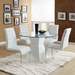 great white all glass dining table idea with modern white chairs and white textured area rug and creamy wall paint and target frame photo