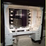 hollywood-style-dressing-table-mirror-with-lights-and-white-stool-and-the-cream-color-floor-and-pictures-with-cabinet-and-purple-wall