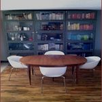 large-Metal-Barrister-Bookcase-Craigslist-with-doors-on-three-coloumns-and-wooden-floor-and-wooden-dining-table-with-white-chairs