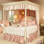 large-and-luxurious-princess-bedroom-themed-for-girls-with-pinky-and-white-color-theme-and-canopy-bed-near-sofa-and-table-lamps-on-the-cabinet