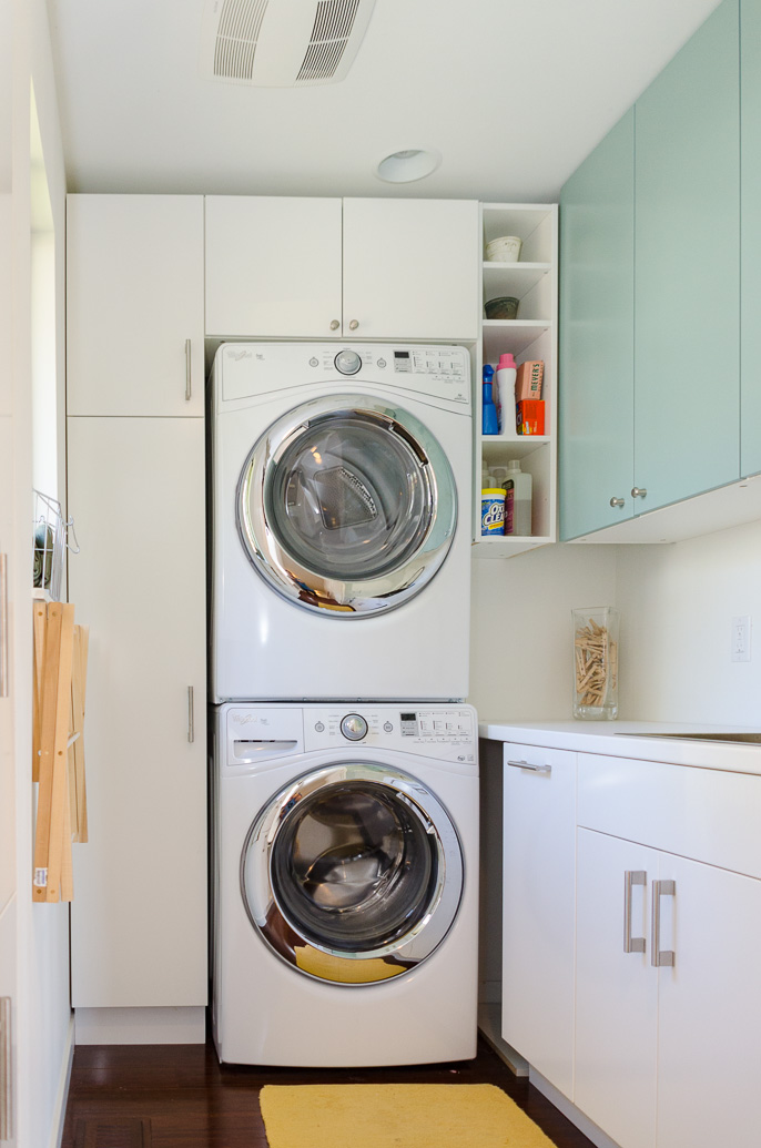 Laundry Room Design With Tall Cabinet Wall System And Under A Washing Machine