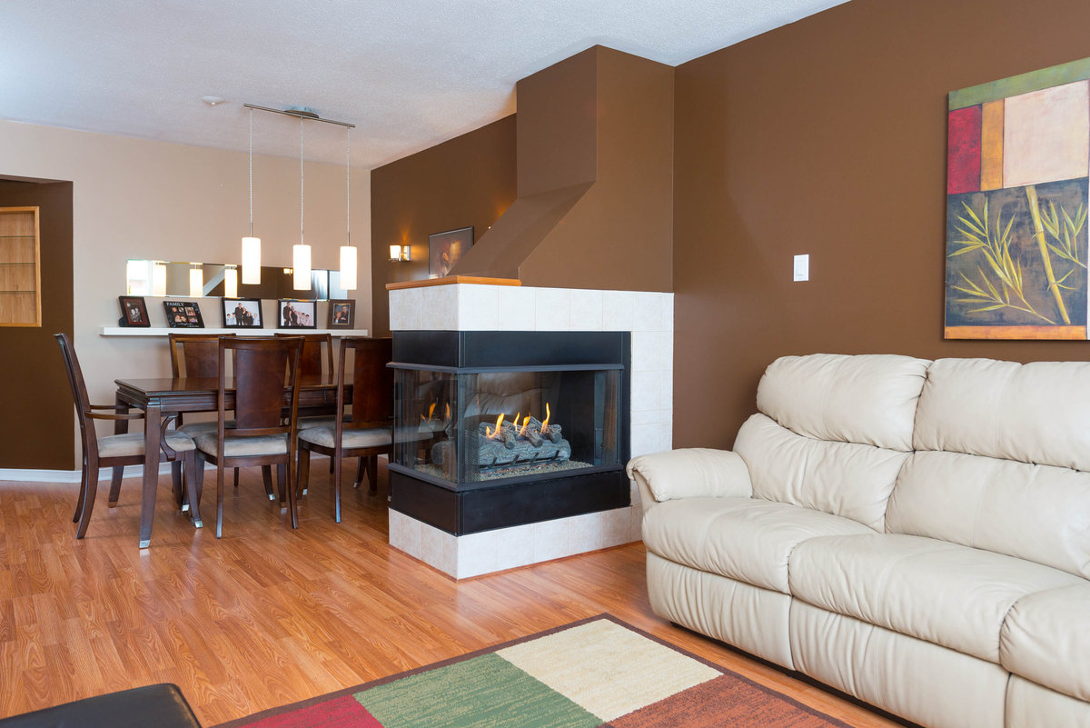 3 sided fireplace best prep for winter homesfeed - Living room carpet ideas ...