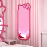 long-and-pink-hellokitty-wall-mirror-on-stripped-pink-wall-with-small-white-table-and-white-bed