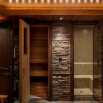 lovable black tone bathroom idea with stone wall accent with glass door and small sauna